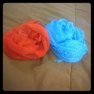 Two fringed chiffon-like scarves